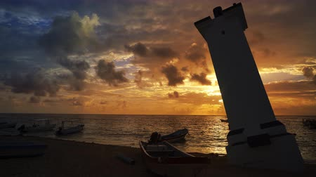 Caribbean lighthouse in Puerto Morelos sunrise in Mayan Riviera of Mexico