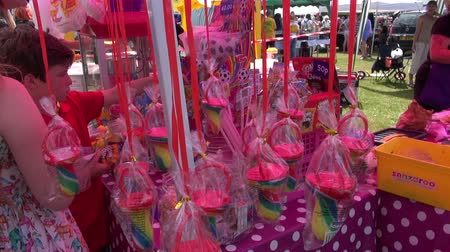 A Sweetie (Candy) Stand At An English Fayre.   Oxted, England - CIRCA July 2015: Children choose sweets (candy) at a stall at a traditional English Fayre, at Oxted, England, on CIRCA July 2015. Стоковые видеозаписи