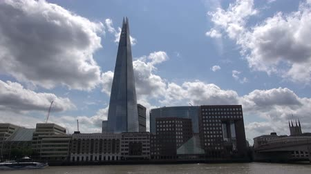 Shard Building At London Bridge - Timelapse.   London, England - CIRCA July 2015: Fast moving clouds pass over Shard London Bridge, GMOUK Offices and London Bridge, at London, England, on CIRCA July 2015. Стоковые видеозаписи