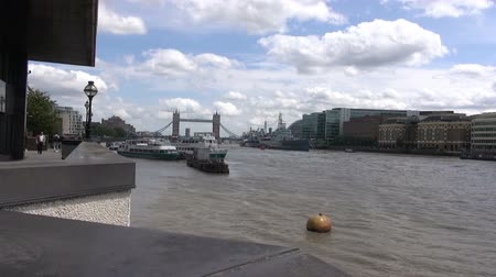 Tower Bridge And HMS Belfast - London - Timelapse.   London, England - CIRCA July 2015: Activity on the river Thames with Tower Bridge and HMS Belfast in the background, at London, England, on CIRCA July 2015.