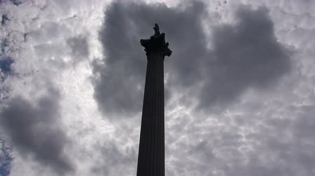 Nelsons Column In Trafalgar Square - London - Timelapse.   London, England - CIRCA July 2015: Back-lit Silhouette of dark clouds passing over Nelsons Column In Trafalgar Square, at London, England, on CIRCA July 2015.