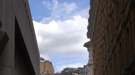 Side Street Off The Strand - London - Timelapse.   London, England - CIRCA July 2015: A narrow side street near The Strand. Near the end of the clip an aircraft exits a cloud and crosses the scene, at London, England, on CIRCA July 2015.