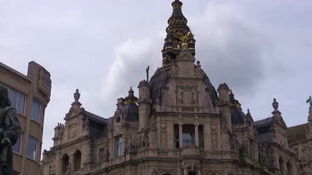 Anvers shopping street - Antwerpen - Belgium - Time-Lapse.   Clouds race over a building in Anvers shopping street, a famous area of Antwerpenn, Belgium. Time-lapse.