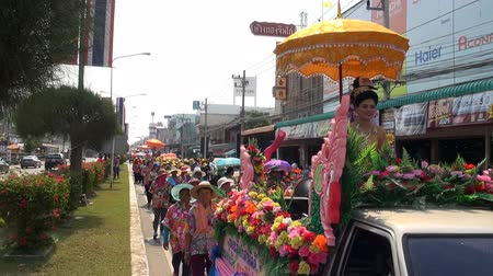 Pageant Queen In A Colorful Parade.   PHETCHABURI, THAILAND - CIRCA APRIL 2016: Zoom out from a beautiful Pageant Queen to reveal the colorful parade. A local pageant at Phetchaburi, Thailand, on CIRCA April 2016.