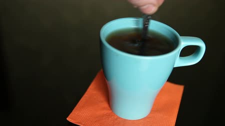 copinho : stirring tea in a blue cup Stock Footage