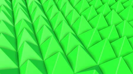 three dimensional : rows of green pyramids slowly moving. abstract. 3d rendering
