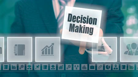 dificuldade : Businessman selecting and then pressing a Decision Making button on a clear projection screen