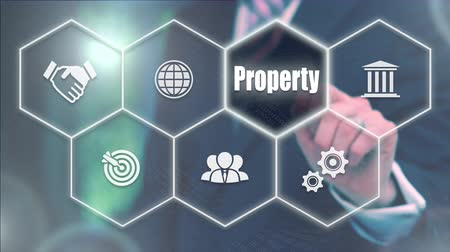 properties : Businessman pressing a Business Property concept Stock Footage