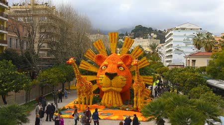 menton : FRANCE, MENTON - FEBRUARY 18: 84th Lemon Festival (Fete du Citron) in Menton town on the French Riviera. Huge citrus constructions made from lemons and oranges on Broadway theme on February 18, 2017 Stock Footage