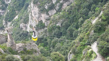 SPAIN, MONTSERRAT - SEPTEMBER 11: Video of Cable car ascending the mountain at Montserrat monastery on September 11, 2015