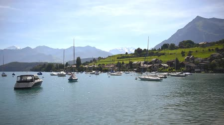 Boats floating on lake Thun Bernese Oberland Switzerland Dostupné videozáznamy