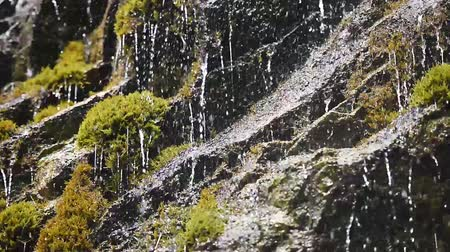 Small waterfall streams in Swiss Alps