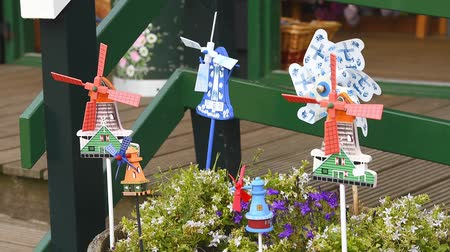Video of small swirling windmill pinwheels in the Zaanstad village Zaanse-Schans, Netherlands