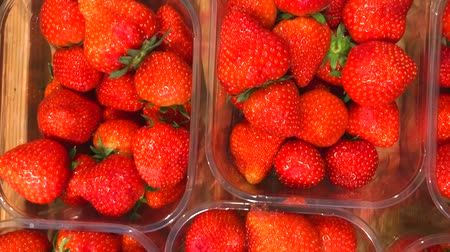Natural organic strawberries in plastic boxes at a supermarket