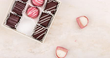 framboesas : Luxury pink handmade chocolate candy stuffed with marshmallow. Exclusive artisan chocolate handcrafted bonbon