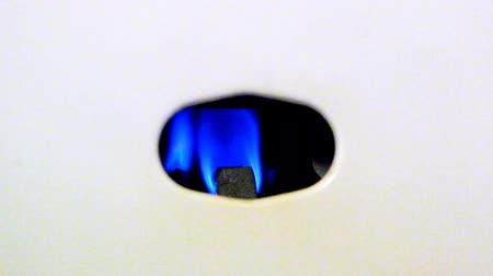 match : Blue fire burning gas nozzle gas water heater
