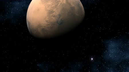 Марс : The major red planet (Mars) slowly flies in depths of space. Against a dark background bright stars, sparks and the star fog flickers. Стоковые видеозаписи