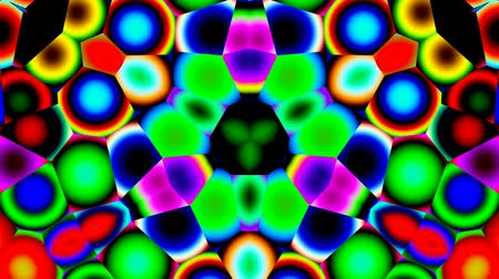 kalejdoskop : Bright color circles and rings slowly change in a kaleidoscope. Wideo