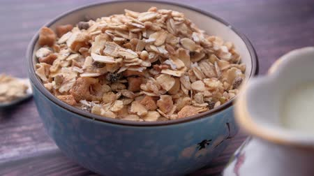 yulaf ezmesi : oats in a bowl with milk on table, closeup