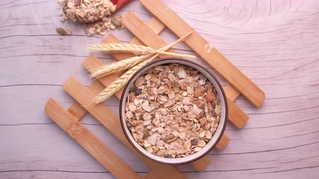 овес : top view of oats in a bowl for morning breakfast Стоковые видеозаписи