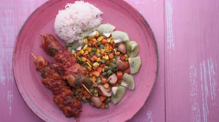 peas : top view of chicken, rice and vegetable on plate