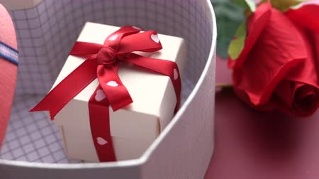 sarıcı : Close up of valentine day gift box on table