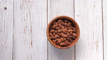 celý : top view of almond in a bowl on table