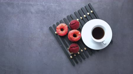 megtöltött : top view of coffee and donuts on table