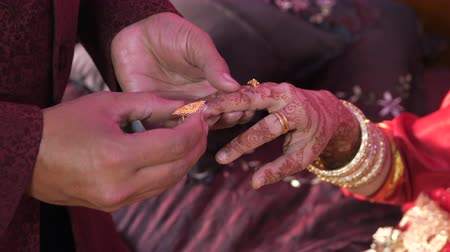 indian couple holding hands at wedding day