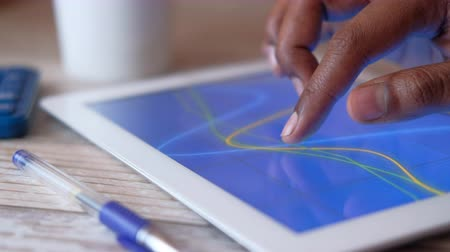 учет : Close up of man hand analyzing chart on digital tablet