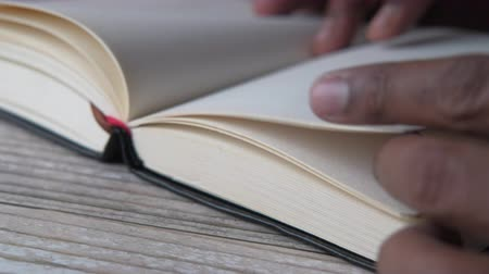 Close up of man hand turning a book page Wideo
