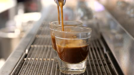 kufel : making coffee or espresso at cafe, pouring coffee in a cup