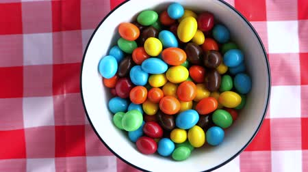 top view of color chocolate in a bowl on table