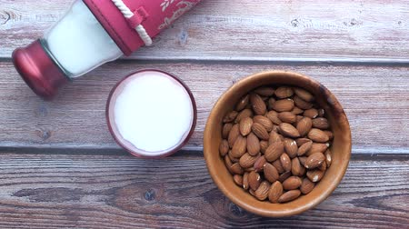 Close up of fresh almond and milk on table