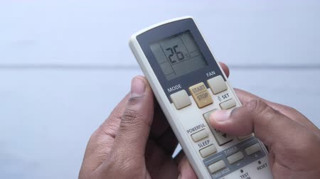 Close up of man hand use air condition remote