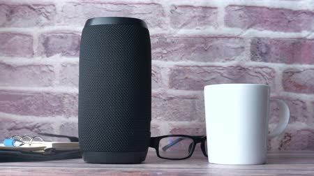 Close up of smart speaker on table against wall