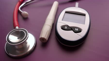 blood sugar measurement for diabetes, pills and stethoscope
