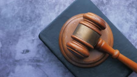 Close up of gavel , book and handcuff on table