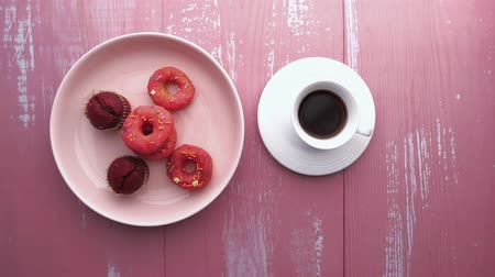 zasklený : Black Coffee with Three Different Donuts on Black Background.