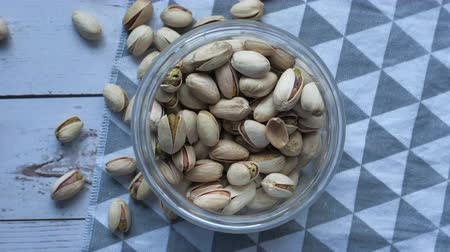 top view of pistachios in a jar on table