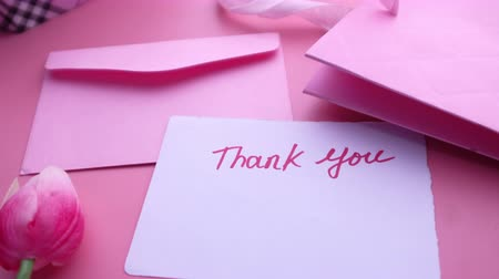 thank you letter with gift box pink background