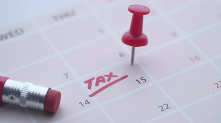 tax day concept with tax word on calendar date