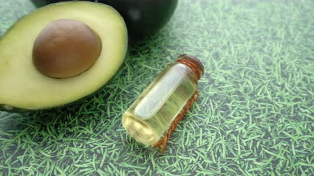 Close up of avocado oil and avocado, health life style Vídeos