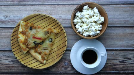 top view of pizza, popcorn and tea on table