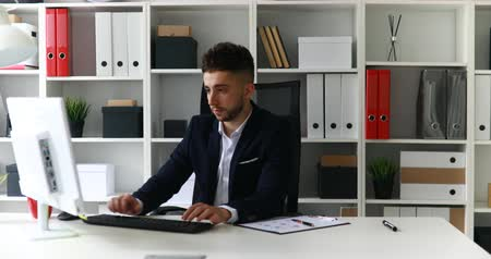 young businessman working on computer in office Dostupné videozáznamy