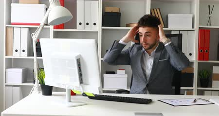 frustrated young businessman working on computer