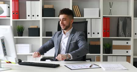 young businessman working and spinning in office-chair Dostupné videozáznamy