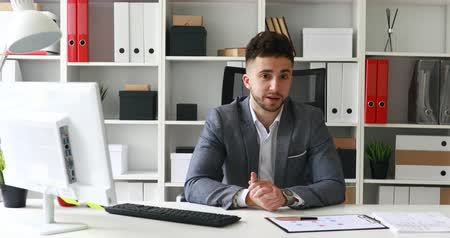 young businessman looking to camera in modern office Dostupné videozáznamy