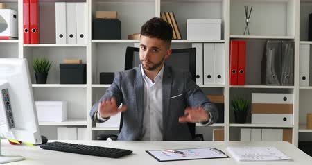 businessman in workplace looking at camera