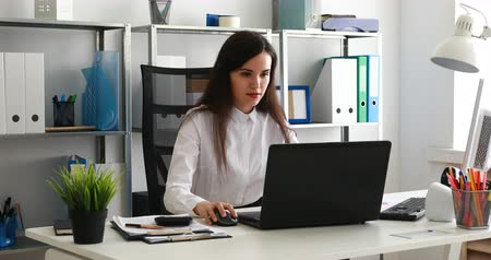 businesswoman working on laptop in modern office